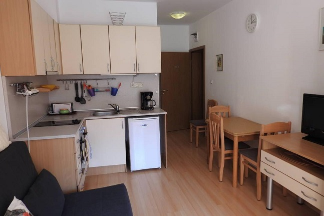 A ground floor fully furnished studio apartment with balcony