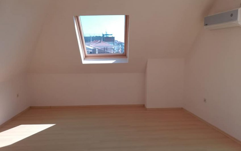 A top floor unfurnished one bed apartment with amazing views