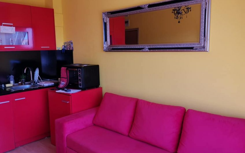 A top floor furnished studio apartment with balcony .